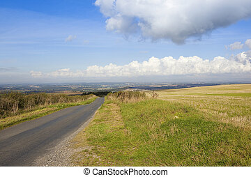 hilltop road - a hilltop road in the yorkshire wolds with...