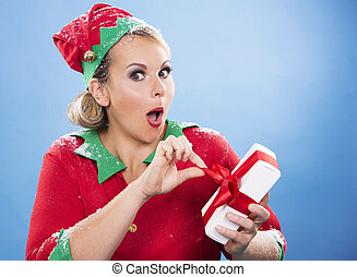 blond elf female opening a present - blonde woman wearing...