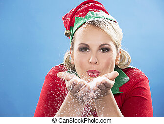 blond elf female blowing snow - blonde woman wearing elf...