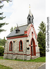 A little stone country church in the beginnings of fall...