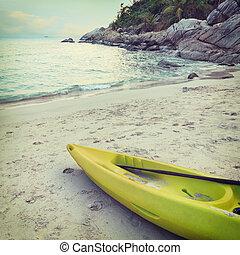 vivid kayak on the sand