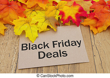 Black Friday Deals Card, Autumn Leaves on weathered grunge...