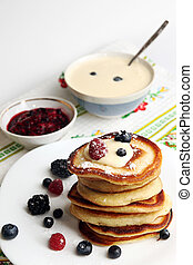 Pancakes with berry, jam and sour cream