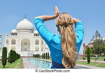 Young woman meditating at Taj Mahal. Agra, India