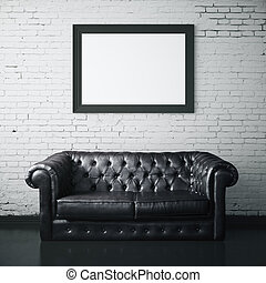 Leather couch and picture frame - White brick interior with...