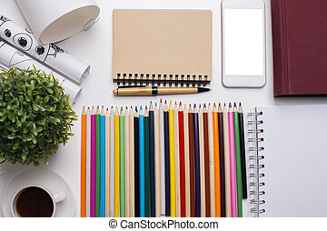 Blank cellphone screen and notepad - Top view of creative...