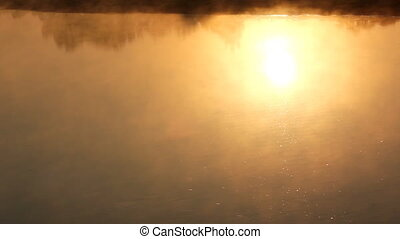sunrise reflection in the river with mist