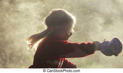 Girl child in smoke - Girl refugee in thick smoke in backlit...