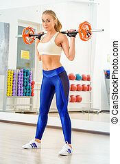 sportswoman - Beautiful athletic woman doing exercises with...
