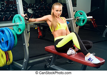 fitness training - Beautiful athletic woman doing exercises...