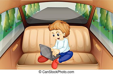 Little boy using computer in the car