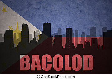 abstract silhouette of the city with text Bacolod at the...
