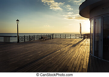 Deck of the new Hasting pier in lat - Sunlight catches the...