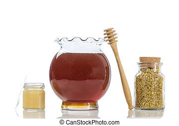 Bee royal jelly pollen in small glass jars with honey and  in a kitchen