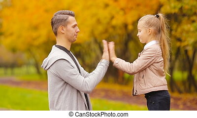Happy family in autumn park outdoors - Father with cute...