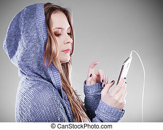 young woman with smart phone listening music Teen stylish...