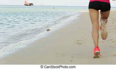 young healthy lifestyle woman running at sunrise beach
