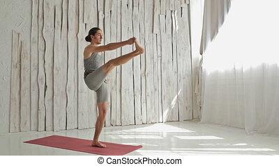 Young sporty man practicing ashtanga yoga - utthita hasta...