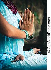 closeup of woman hands practice yoga outdoor