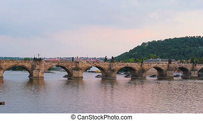 Charles bridge in the old town of Prague at sunset, Czech...