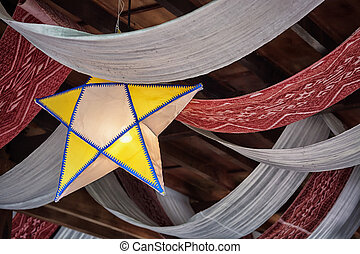 Decorations on the ceiling from fabric in the form of stars...