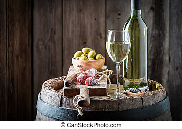 Chardonnay wine with olives and cold cuts
