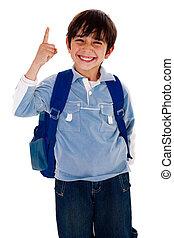 Cute young boy pointing upwards - Happy school boy pointing...