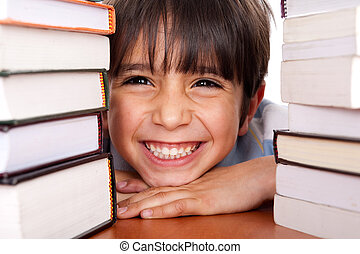 Close-up of young school kid - Young boy smiling at camera...
