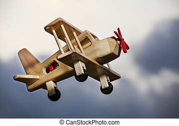 Wooden plane flying under a storm - Wooden plane flying...