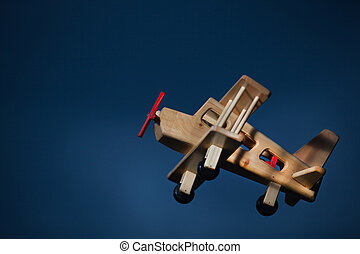 Wooden plane flying at dusk -  Side view