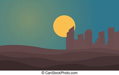Silhouette of urban city on desert