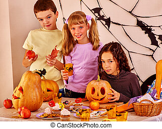 Children look forward to Halloween. They make carved...
