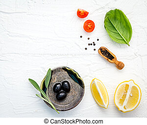 Food background with fresh herbs tomato ,lemon slice , black...