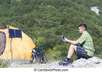 Camping on the mountain top. - The solar panel attached to...