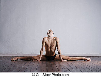 Young and fit modern dancer performing a move - Handsome...