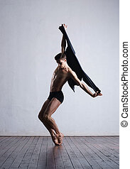 Young and fit modern dancer performing a move - Athletic...