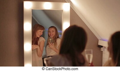 Two Girls Primp In A Mirror Together smiling dance