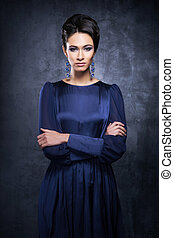 Young woman in a beautiful evening dress - Young and...