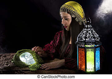 Psychic Holding a Crystal Skull - Female psychic or fortune...