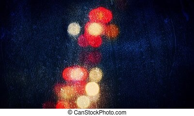 Car Lights Bokeh Rainy Window - City road lights with rain...
