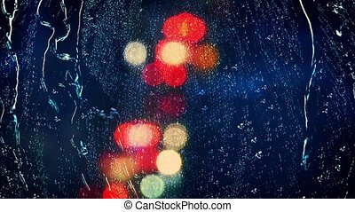 View Through Window Rainy Night - Colorful car lights with...