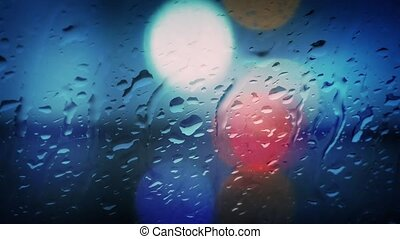 Traffic Lights Through Rainy Glass - Out of focus car lights...