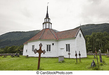 Traditional norwegian white wooden church. Stordal village....