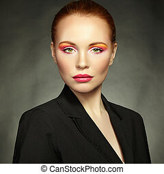 Beauty portrait of woman with beautiful makeup. Fashion...