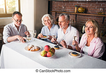 Happy family having holiday diner together