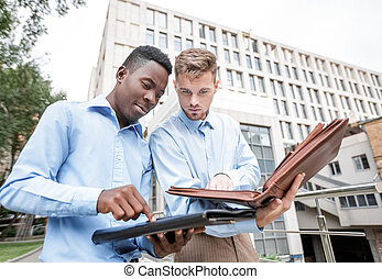 two businessmen discussing project - African American...
