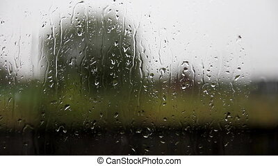glass window with raindrops