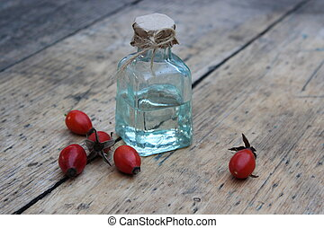 The bottle of rose hip oil - Glass bottle with oil and...