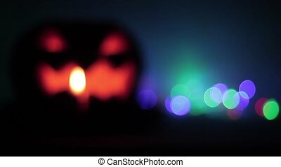 Defocused Closeup of scary holiday halloween carved glowing...