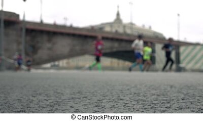 Blurred runners. Healthy lifestyle concept. Slow motion...